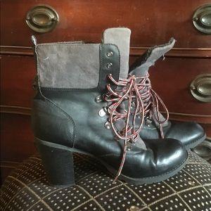 Report high heeled boot